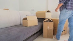Family moving out of their old apartment and carrying boxes from the room Stock Footage