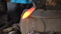 Blacksmith working metal with hammer Stock Footage