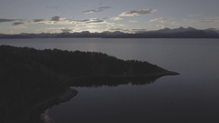Aerial Drone Shot over Water at Sunrise Stock Footage
