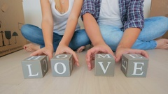 Young family making words Home and love on toy wooden blocks Stock Footage