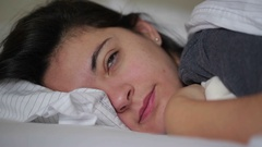 Woman in her late 20s wake-up from afternoon nap. Stock Footage