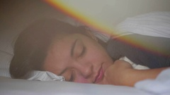 Artistic prism effect of woman sleeping during afternoon nap. Stock Footage