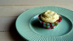 Chef put cupcake plate on white wooden table. Sweet cupcake on dessert plate Stock Footage