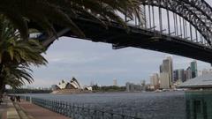 Sydney Opera House behind harbour Bridge Stock Footage