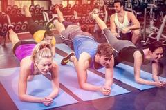 Group of people working their abs Stock Photos