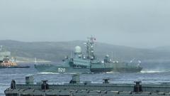 "Past the cruiser ""Admiral Kuznetsov"" floats a small rocket ship ""Rassvet"". Stock Footage"