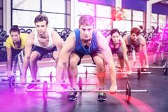 Portrait of athletic men and women working out Stock Photos