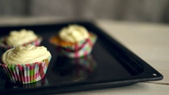 Making muffins. Cooking cupcakes. Hand take away cake from baking tray Stock Footage