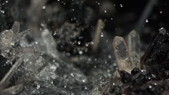 Water splash in crystal natural cave. Super slow motion close up. Stock Footage
