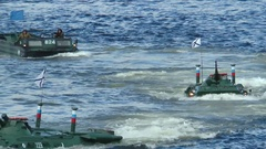 Severomorsk, RUSSIA . Kola Bay. Floating armored vehicles  swim to shore. Stock Footage