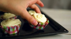 Cooking cupcakes. Hand put cup cake on baking tray. Homemade cupcakes Stock Footage