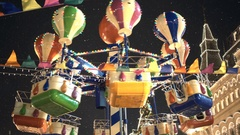Carousel against dark night sky on the Red Square. Lights of State Department Stock Footage