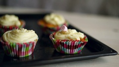 Marshmallow candies falls to muffin. Decorating cupcake Stock Footage