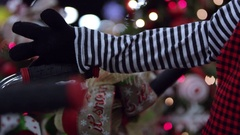Pan of christmas doll up the arm to the face Stock Footage