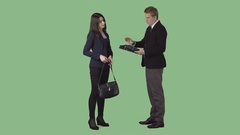 Man in business clothes is standing with beautiful girl and watching documents Stock Footage