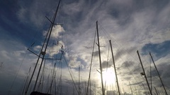 Sailboat Masts silhouette at Harbor with cloudy sky Stock Footage