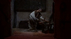 Carpenter with a saw cuts wood Stock Footage