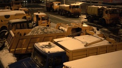 Snow-plough machinery on a city street. Truck full of snow. Cars passing by Stock Footage