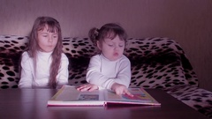 Children reading the book. Stock Footage