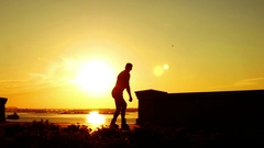 People walking on evening embankment Stock Footage