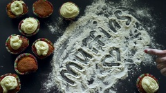 Inscription 'Muffins' on flour background. Cooking concept. Muffins background Stock Footage
