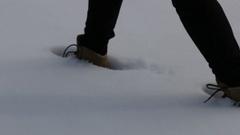 Walking through snow in Snowy Mountains Australia Stock Footage