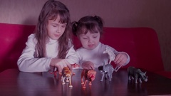 Children playing with toy animals. Stock Footage