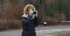 Young beautiful female girl photographer taking photos with camera Stock Footage
