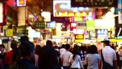 Crowds of people at Sai Yeung Choi Street in Mongkok district, Hong Kong at nigh Stock Footage
