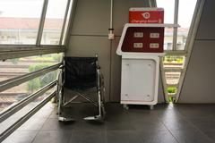 Charging place facility and wheel chair fo dissable people provided for commuter Kuvituskuvat