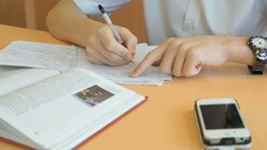 Student writes the text in a copybook on a lesson Stock Footage