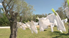 Clothes and wind.  Use high quality washing powder. Stock Footage