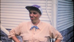 A woman puts together a disguise for Halloween, 3974 vintage film home movie Stock Footage