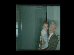 Proud Grandfather kissing and holding infant baby grandson lovingly Stock Footage