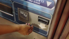 Hand Inserting Plastic Bill In ticket Machine, Close Up Detail Stock Footage