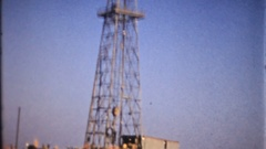 Oil rigs on the shoreline of Long Beach Harbor 1940, 3970vintage film home movie Stock Footage