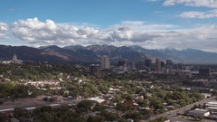 Wide aerial view of Salt lake City and Wasatch Mountains Stock Footage