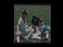 2 boys and baby play with dog Stock Footage