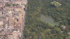 AERIAL: Flying above Upper West side overlooking green Central park in New York Stock Footage