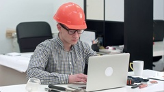 Young architect working on the laptop in office Stock Footage