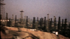 Oil fields in Signal Hill, Long Beach, California, 3969 vintage film home movie Stock Footage