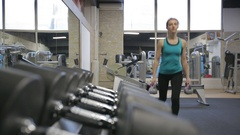 Young athletic woman exercise reverse lunges with kettlebell, camera slider Stock Footage