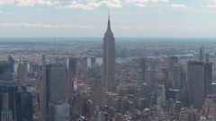 AERIAL: Flying above New York City skyscrapers and condo buildings on sunny day Stock Footage