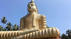 Big shining statue of Buddha in Sri Lanka Wewurukannala Vihara Stock Footage
