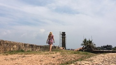 Beautiful girl walks in the Galle Fort in Sri Lanka an island on a hot sunny Stock Footage