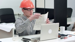 Engineer explaining technical drawing during video call via laptop Stock Footage