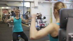 Young athletic woman exercise shoulder, military shoulder press Stock Footage