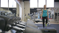 Young athletic woman exercise step-ups with dumbbells, camera slider Stock Footage