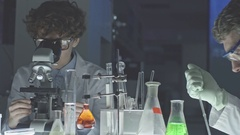 Hardworking Scientists in Laboratory Stock Footage