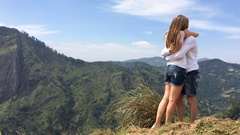 Young man made a marriage proposal to his beloved on a mountain top Stock Footage